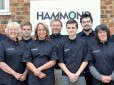 Staff at Hammond Drysuits, inc. owner Chris Hammond (centre)